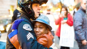141129122705-portland-ferguson-protest-hug-story-top