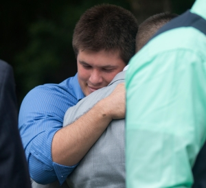 Joshua hugging Jared